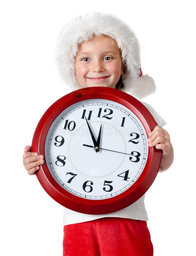 Cute little girl in santa cap with a clock. Isolated oin white royalty free stock photos