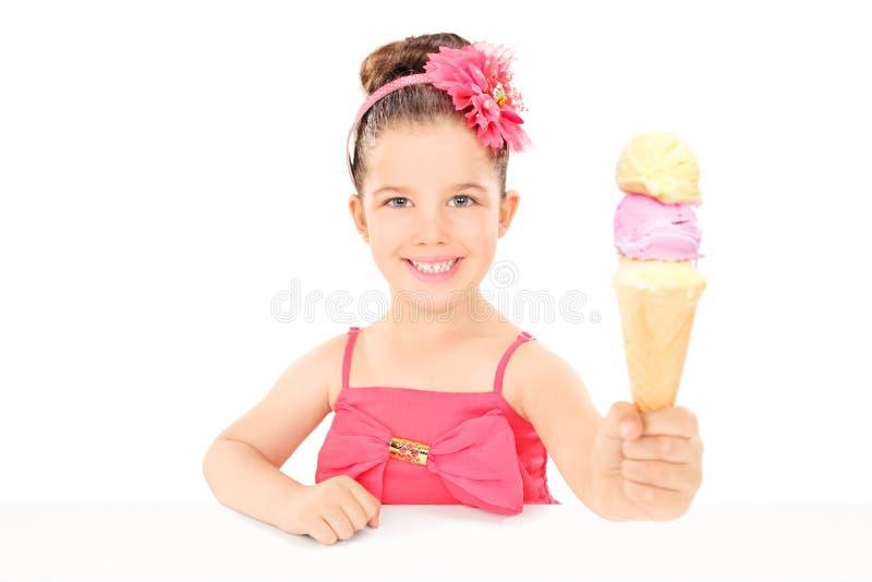 Cute little girl sharing an ice cream royalty free stock photos