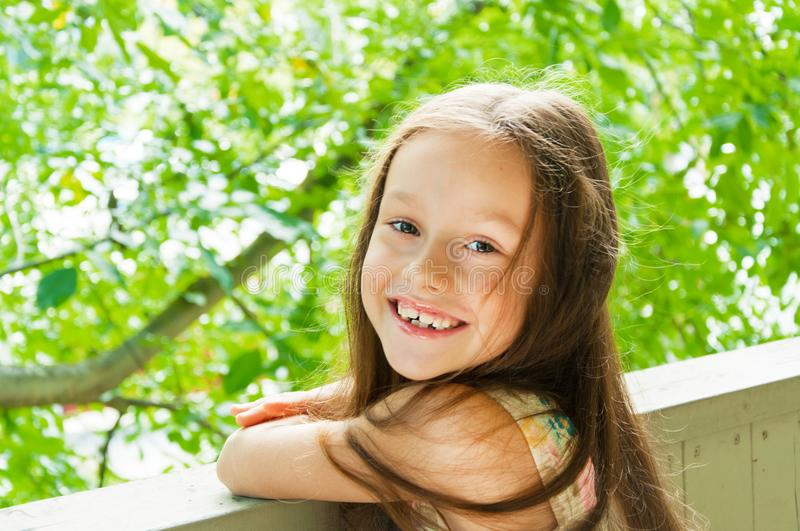 Cute little girl shone with happiness stock images