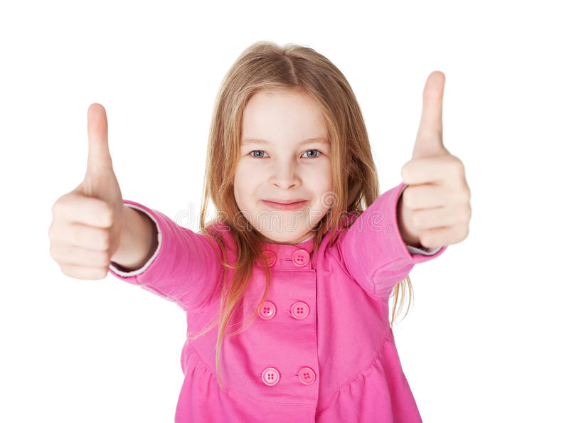 Cute little girl showing thumbs up royalty free stock photo