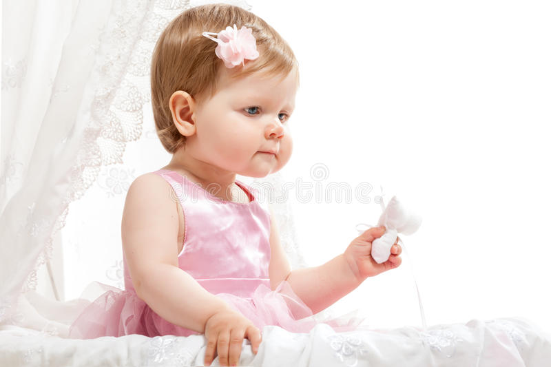 Cute Little Girl Sitting In Baby Buggy Royalty Free Stock Photography