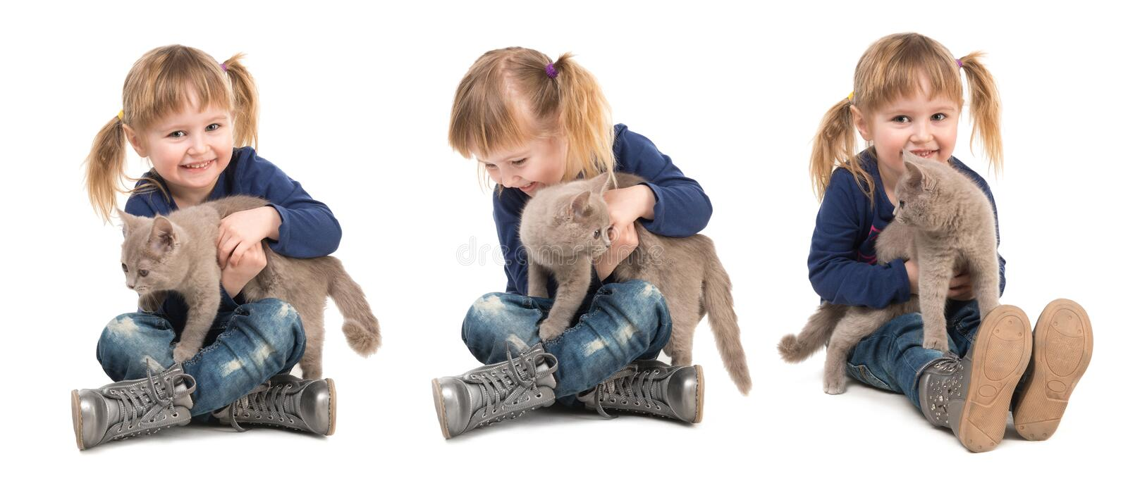 Cute little girl with cat in hands. Cute little girl sitting on the floor with cat in hands isolated on white background royalty free stock photography