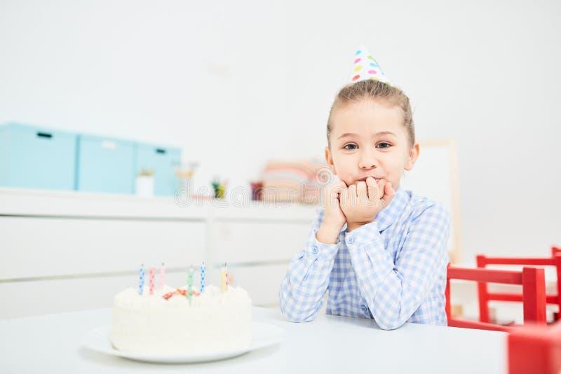 Girl with birthday cake stock photography