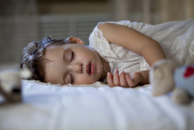 Cute little girl sleeping stock photos