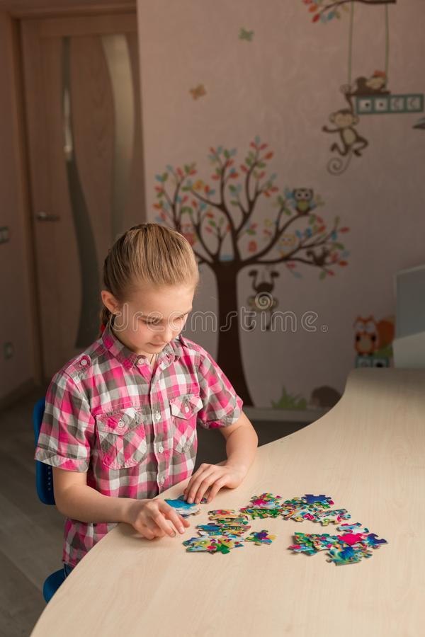 Cute little girl solving puzzle together royalty free stock image