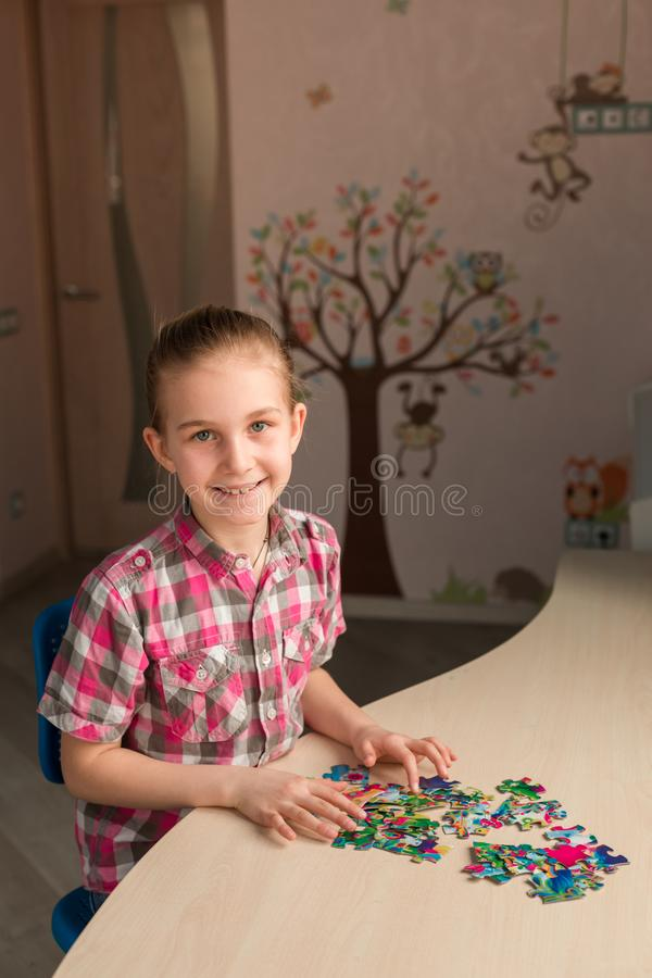 Cute little girl solving puzzle together royalty free stock photos