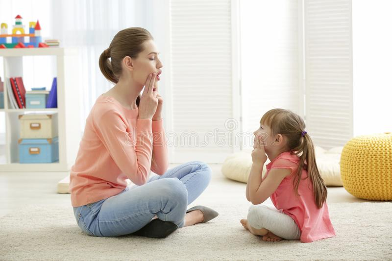 Cute little girl at speech therapist stock photo