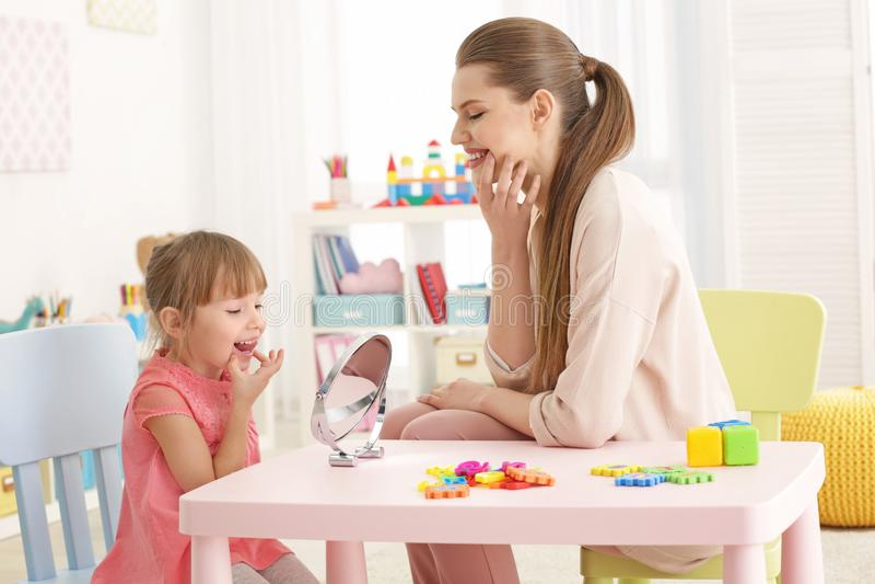 Cute little girl at speech therapist stock image