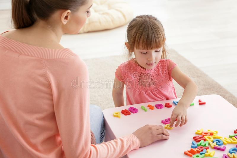 Cute little girl at speech therapist royalty free stock photography