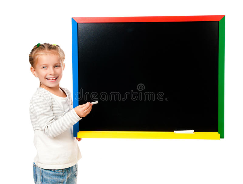 Cute little girl standing near blackboard. Isolated on white royalty free stock photos