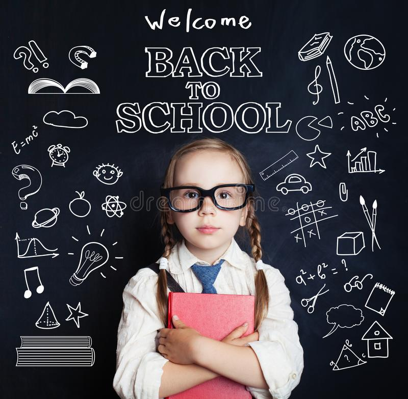 Cute little girl student portrait. Pupil child in classroom stock images