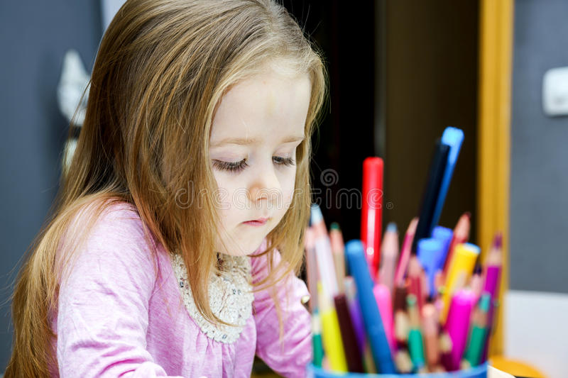 Cute little girl studing to speaking and writing letters at home stock images