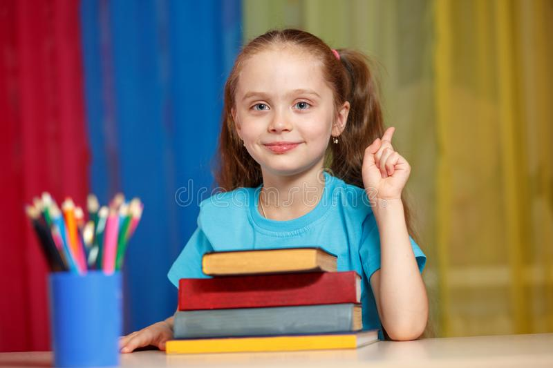 Cute little girl with books royalty free stock photo