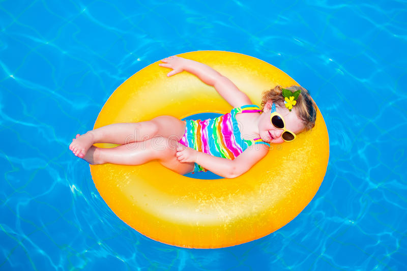 Cute Little Girl In Swimming Pool On Inflatable Ring Stock Photo Image 55004825