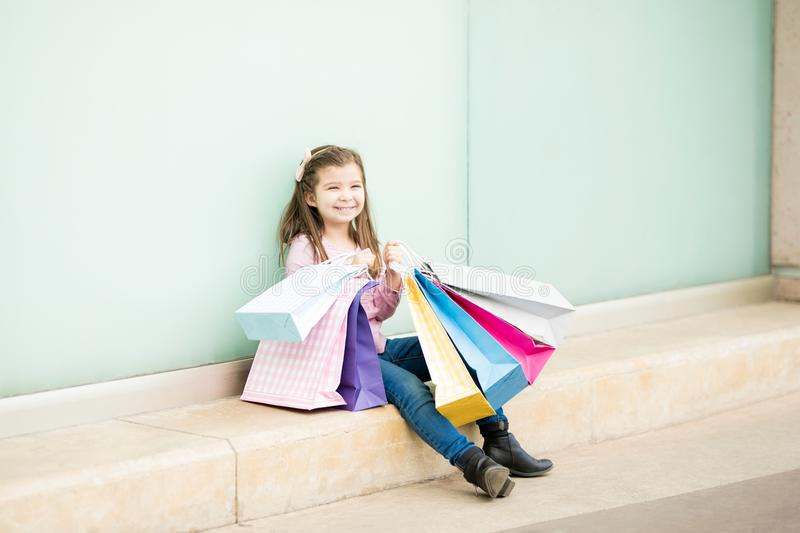 Cute little girl taking break after shopping free royalty free stock images
