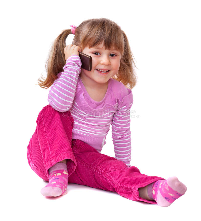 Cute little girl is talking on cell phone stock photos