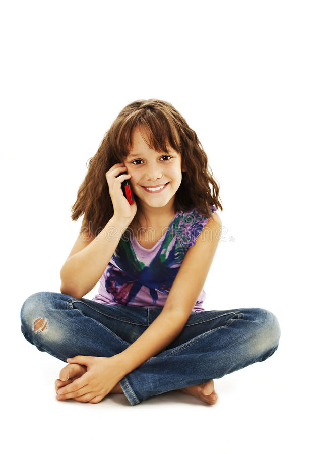Cute little girl is talking on cell phone. On white background stock images