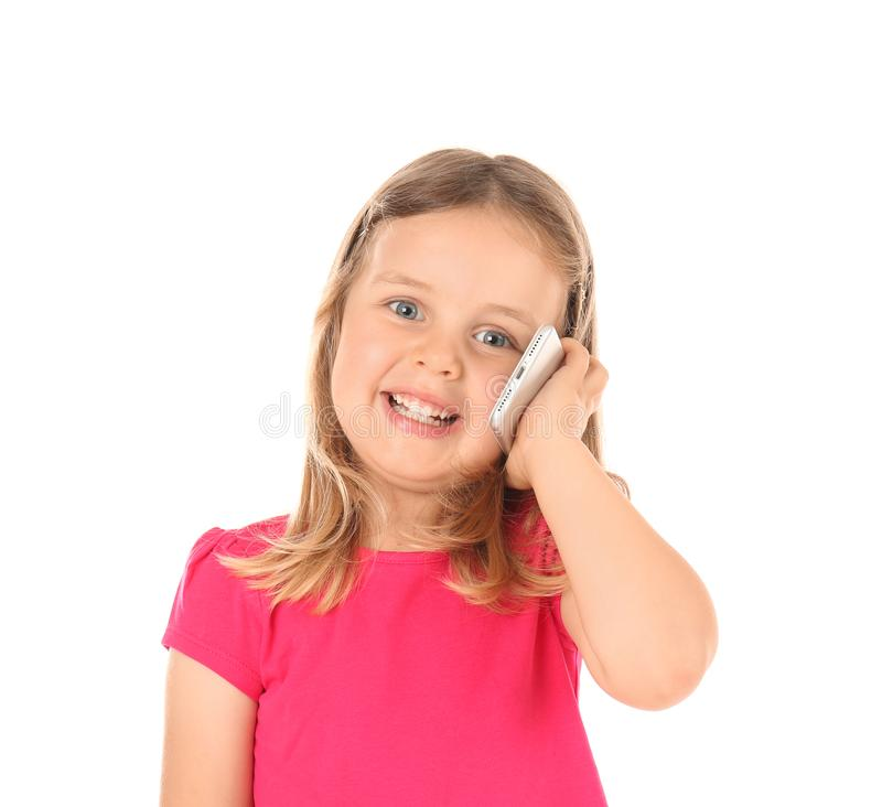 Cute little girl talking on mobile phone against white background royalty free stock photography
