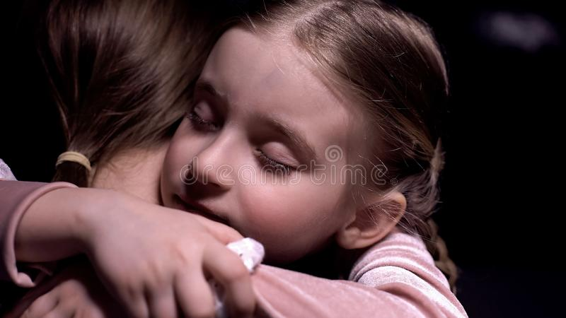 Cute little girl tightly hugging her mother after long separation, tenderness royalty free stock photo