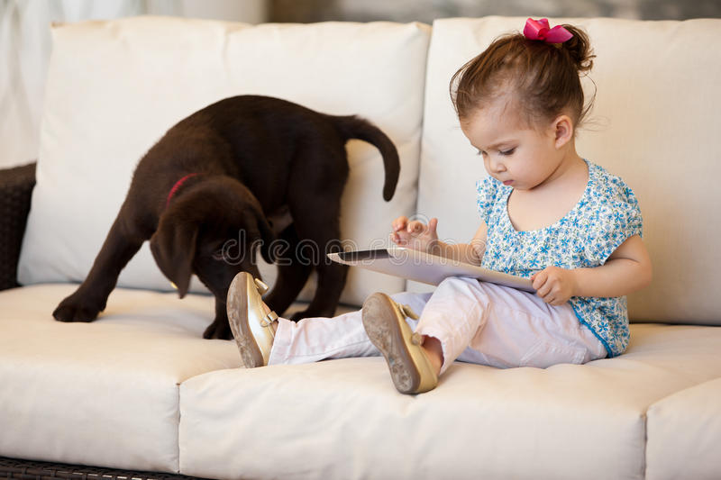 Cute little girl using a tablet royalty free stock photo