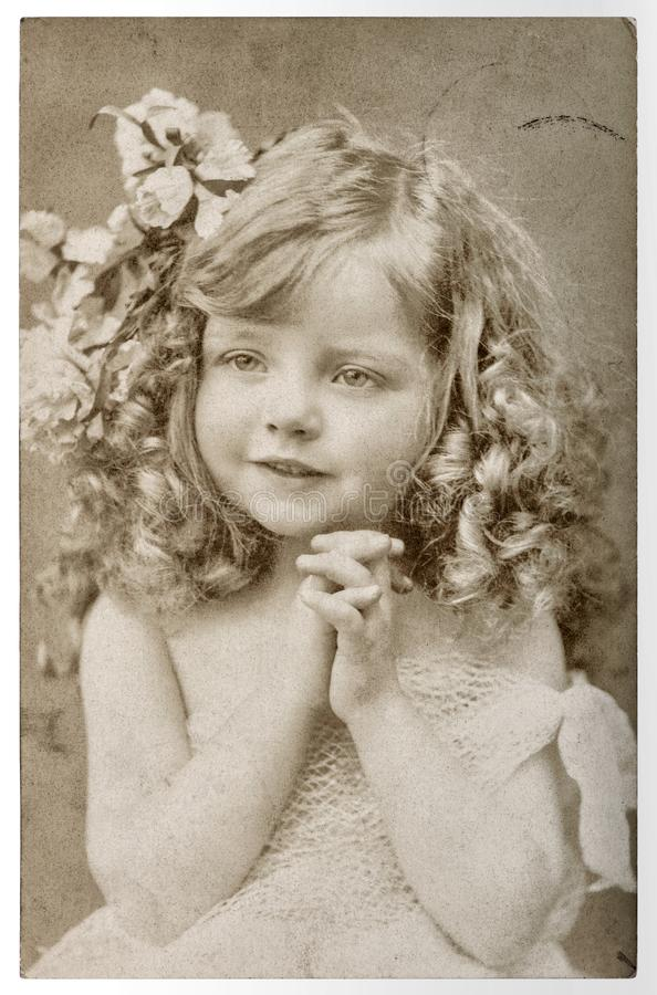 CUte little girl Vintage portrait picturefilm grain blur. CUte little girl. Vintage portrait picture with original film grain and blur royalty free stock photography