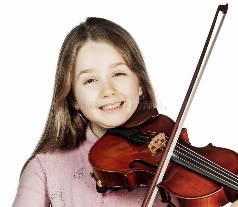 Cute little girl with violin, music and educational concept, isolated on white. Cute emotive little girl with violin, music and educational concept, isolated on royalty free stock image