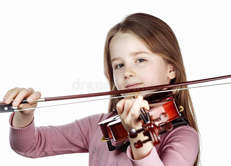 Cute little girl with violin, music and educational concept, isolated on white. Cute emotive little girl with violin, music and educational concept, isolated on stock photo