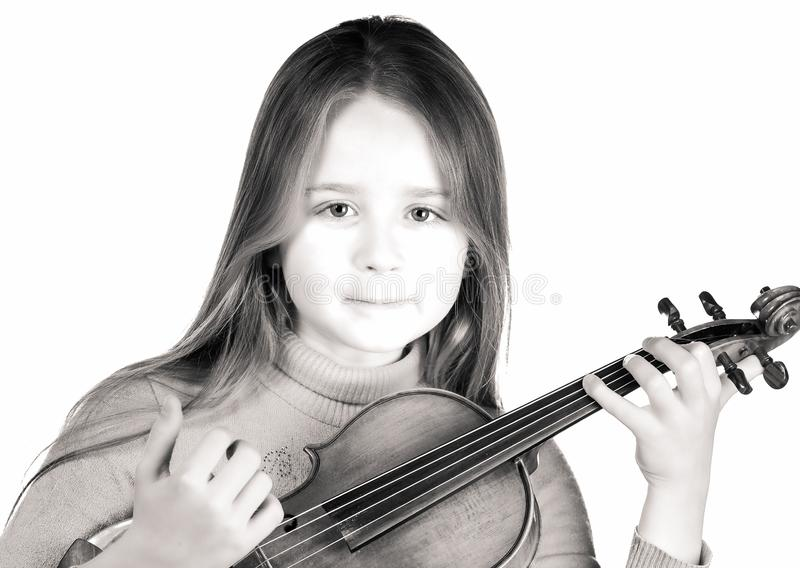 Cute little girl with violin, music and educational concept, isolated on white. Cute emotive little girl with violin, music and educational concept, isolated on stock image