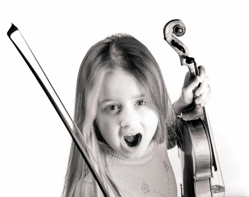 Cute little girl with violin, music and educational concept,  on white. Cute emotive little girl with violin, music and educational concept,  on white stock photos