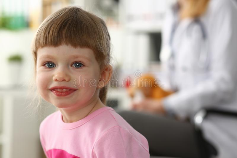Cute little girl visiting family doctor office. Portrait stock photo