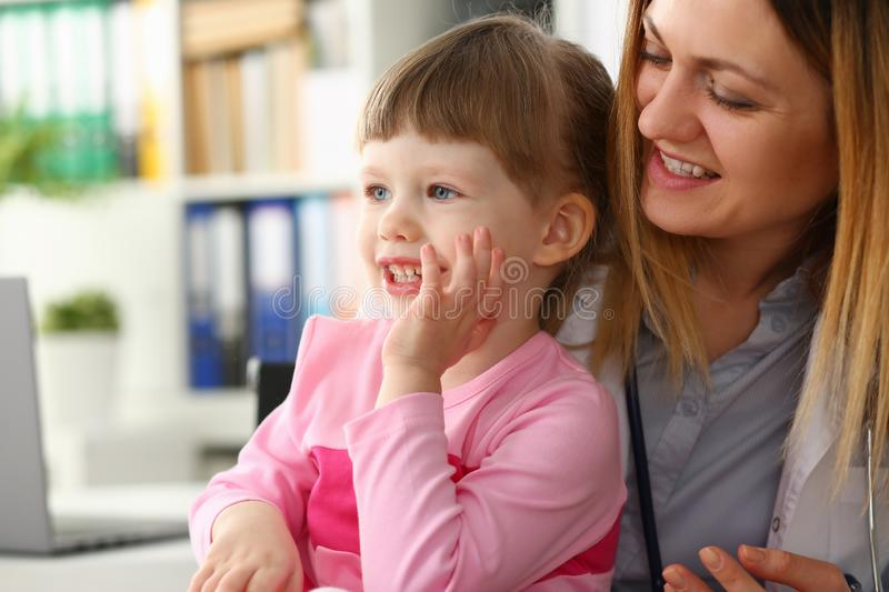 Cute little girl visiting family doctor office. Portrait royalty free stock images