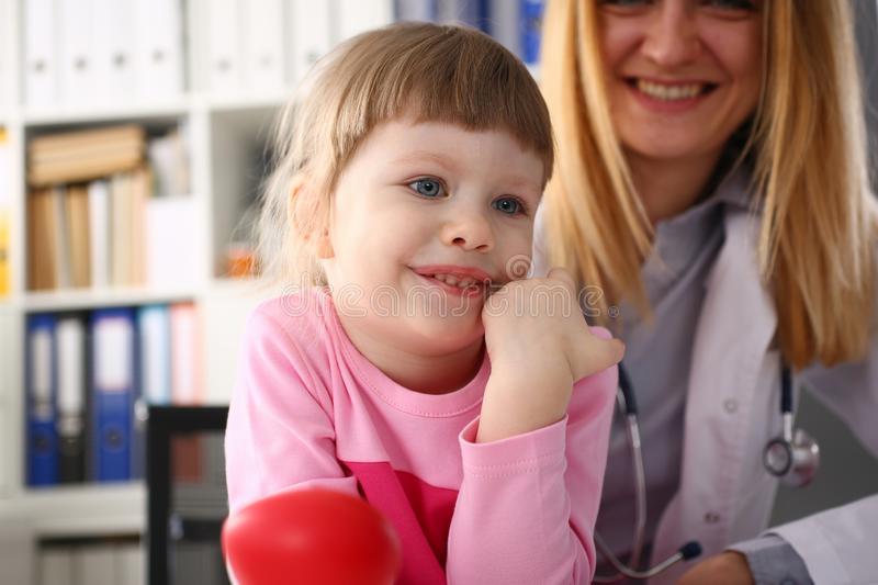 Cute little girl visiting family doctor office. Portrait royalty free stock photos