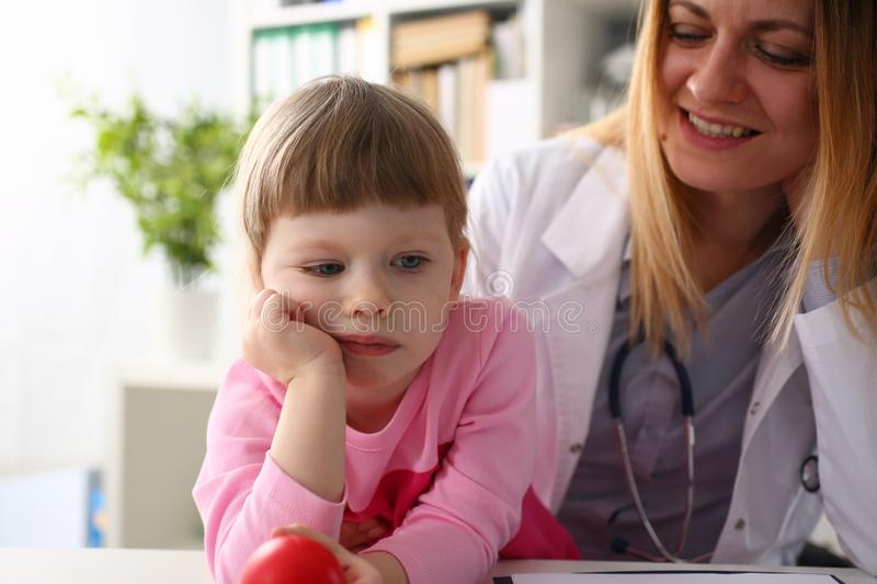 Cute little girl visiting family doctor office. Portrait royalty free stock photo