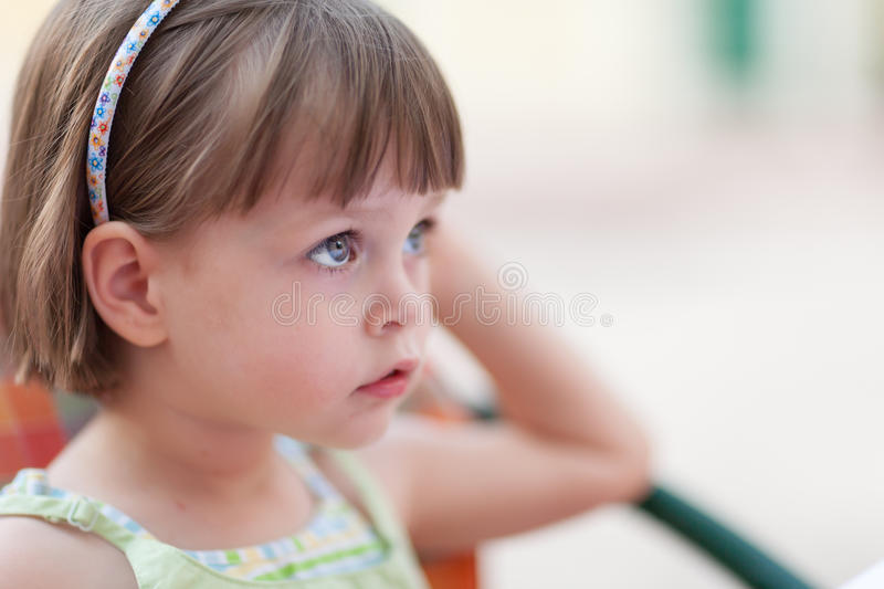 Cute little girl waiting for someone or something stock photos