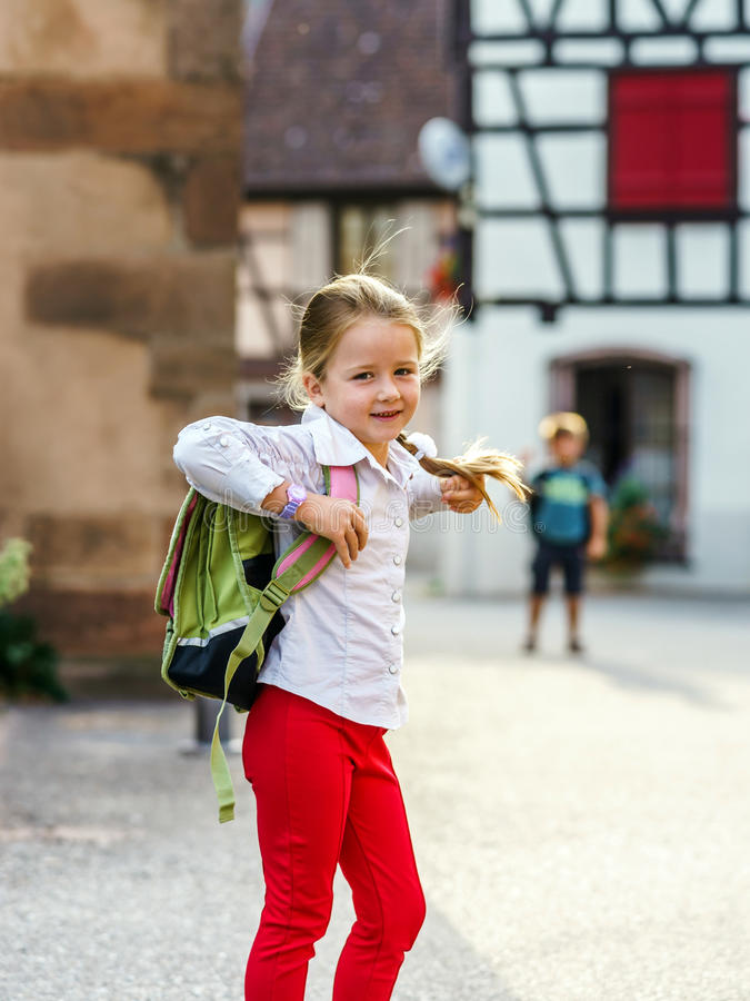 Cute little girl on the way to school. First time to school. Cute little girl on the way to school royalty free stock images