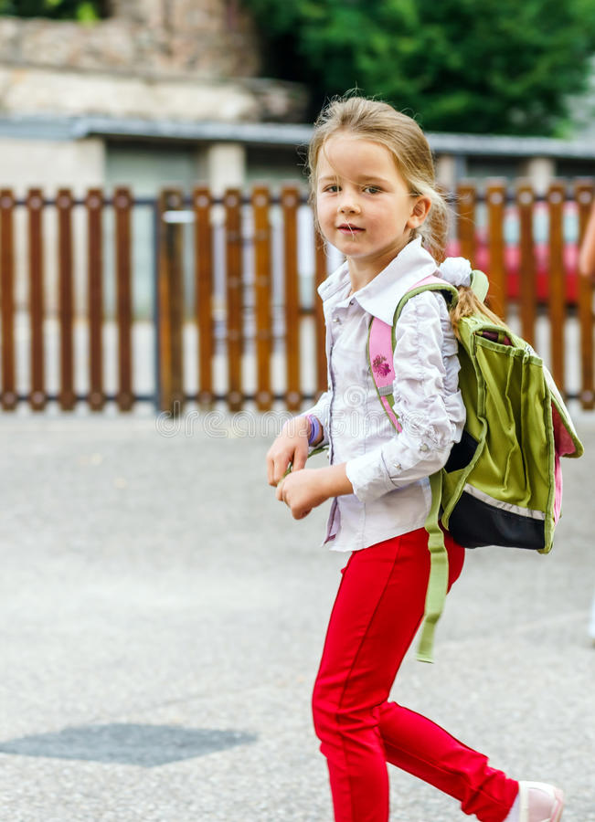 Cute little girl on the way to school. First time to school. Cute little girl on the way to school royalty free stock photo