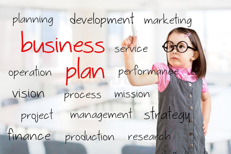 Cute little girl wearing business dress and writing business plan concept. Office background. Cute little girl wearing business dress and writing business plan stock photo