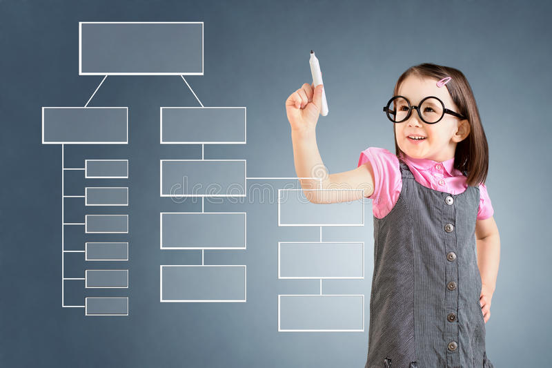 Cute little girl wearing business dress and writing process flowchart diagram on screen. Blue background. Cute little girl wearing business dress and writing royalty free stock photos