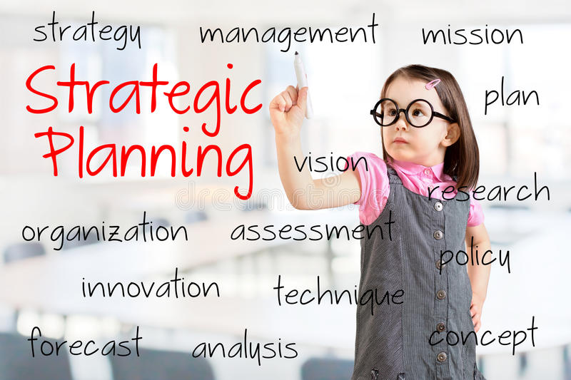 Cute little girl wearing business dress and writing strategic planning concept. Office background. Cute little girl wearing business dress and writing strategic stock photos