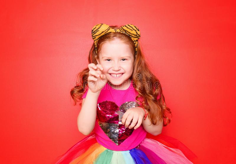 Cute little girl wearing festive clothes on color background. Birthday celebration royalty free stock photo