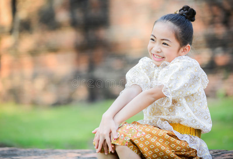 Cute little girl wearing typical thai dress and smile royalty free stock photography