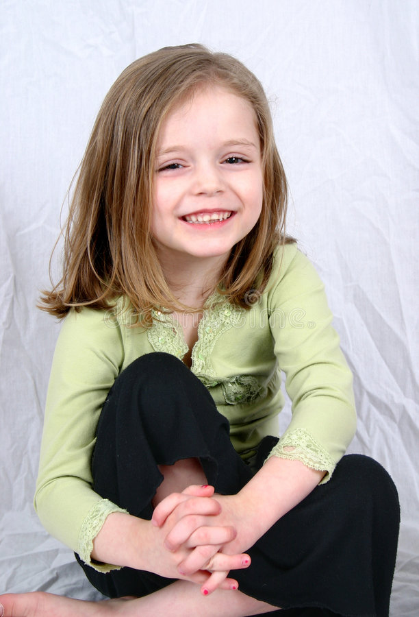 Cute little girl on a white stock photo
