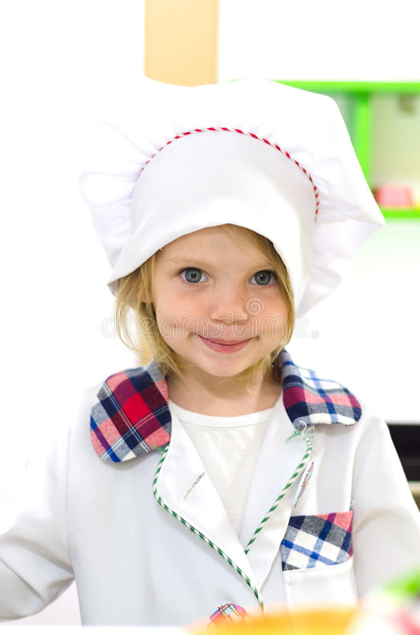 Cute little girl in white chief costume royalty free stock photos
