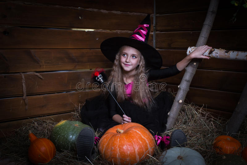 Cute little girl witch. In black dress royalty free stock photos