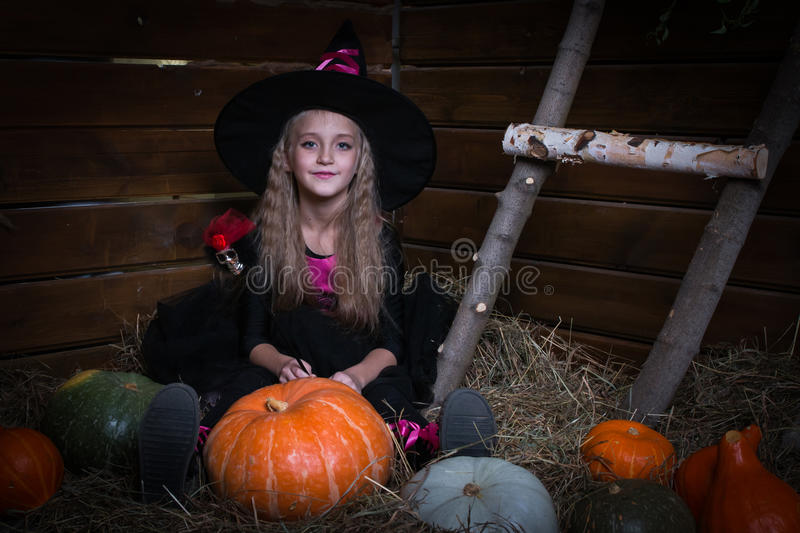 Cute little girl witch. In black dress stock photography
