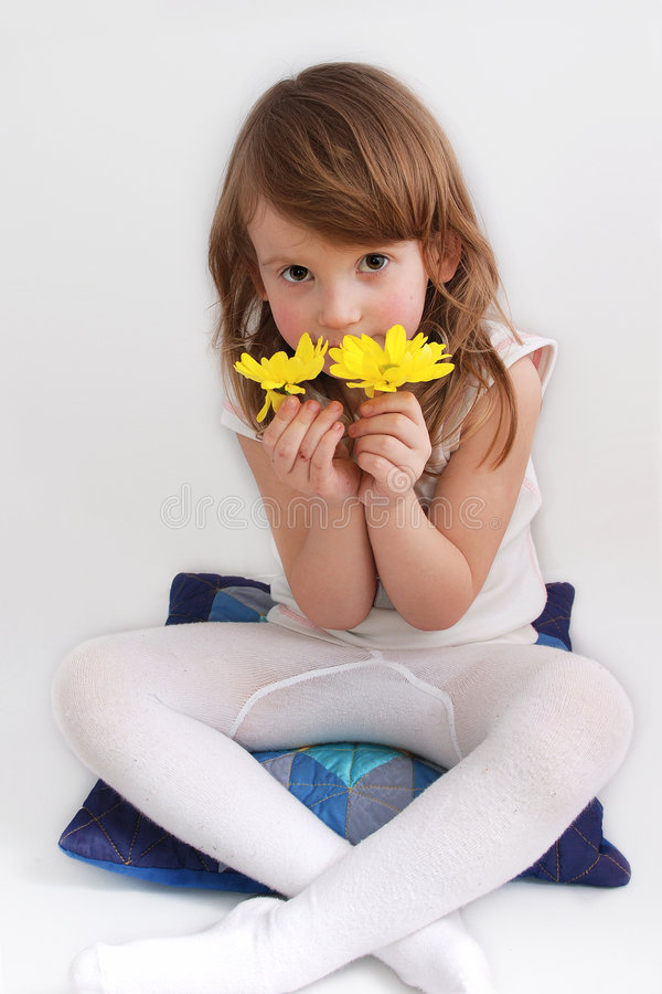 Cute little girl with yellow daisies royalty free stock photo