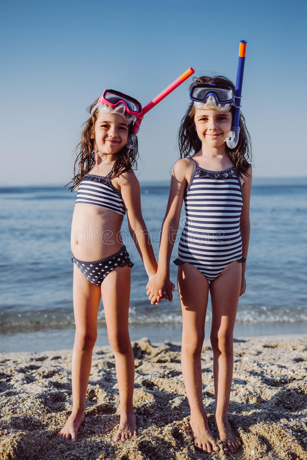 Cute little girls on the beach royalty free stock images