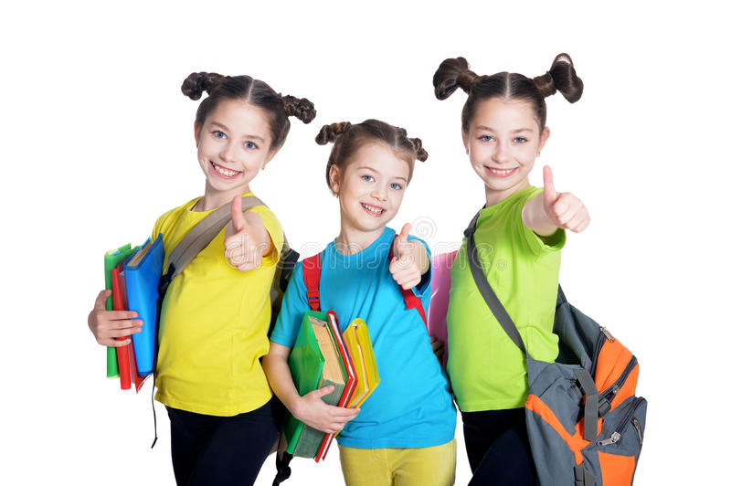 Cute little girls with book. Portrait of cute little girls with book posing in studio stock photography