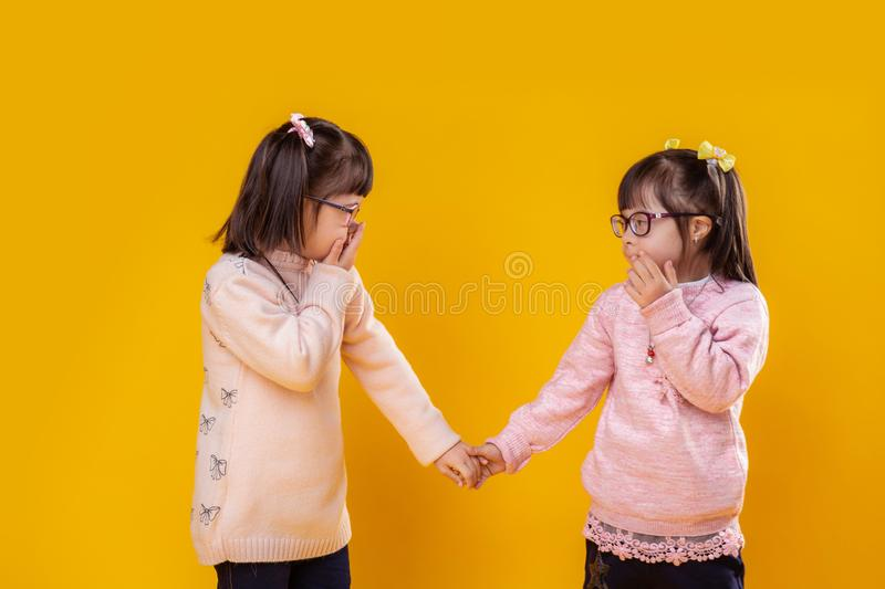 Cute little girls suffering from chromosome abnormality royalty free stock photo