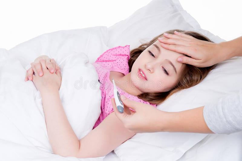 Cute little ill girl with a thermometer. stock photos